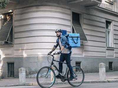 Man on bike Courier