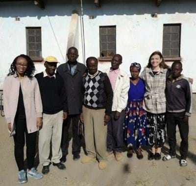 2 Leigh Day staff with 6 Zambian villagers looking at the camera