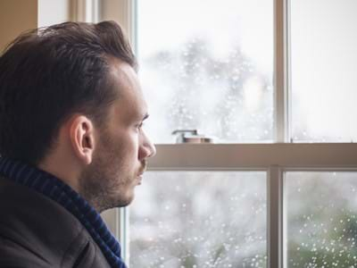 mens health - A man looking out window