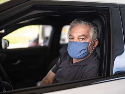 driver senior wearing protective medical mask