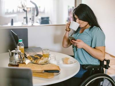 women in wheelchair working from home
